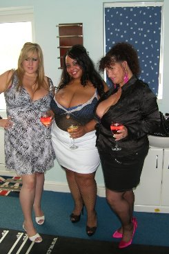 PICTURE SET: Trio of Big Boobed Women Share a Cock
