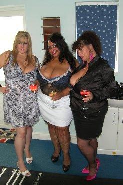 PICTURE SET: Trio of Big Boobed Women Share a Cock
