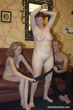 PICTURE SET: Redhead wife joins in with a swinging couple