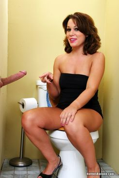 PICTURE SET: At the gloryhole in a little black dress