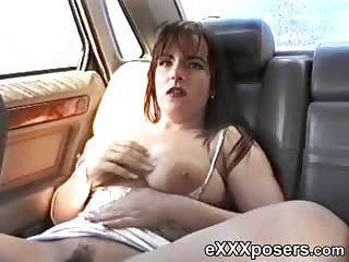 Busty Show Off In Back of the Car