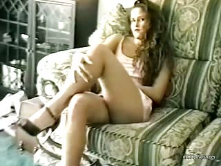 Teen candidly plays on the couch
