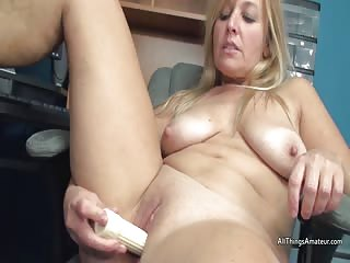 Mature Liisa using a dildo on her shaven smooth pussy