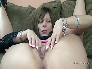 Mature shows off her pussy