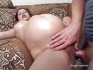 Big pregnant belly and dark nippled amateur gets pussy licked and fucked