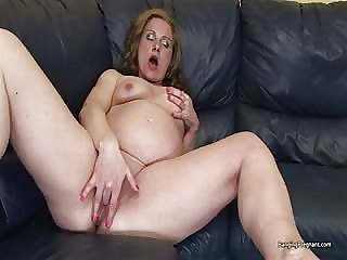 Older pregnant lady plays with her pussy