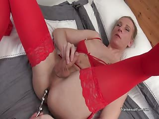 Redvex uses a metal beaded anal toy on herself
