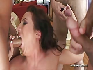 MILF deepthroats and gets a rough mouth fucking from a group of guys before oral cum and swallow
