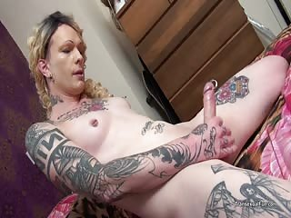 Tattooed tranny plays with herself