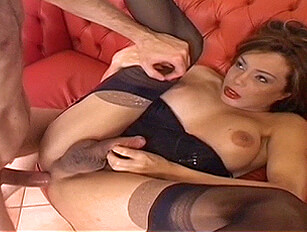 Shemale in stockings and suspenders and a man fuck each other