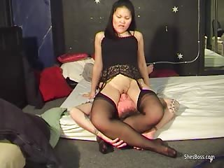 Thai Sammy plants her smooth shaved pussy over a guys face and dominates him