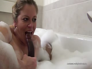 Older chubby sucks and fucks big black cock in the tub