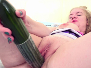 Lily fucks her pussy with toys and a cucumber
