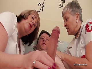 Mature nurses relieve a male patient