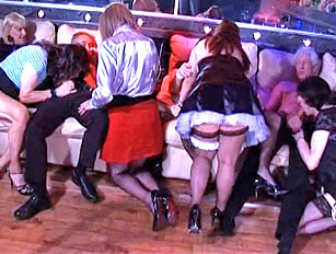 Younger fat girl with a group of old crossdressers and men