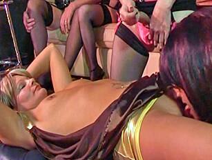 Crossdressers circle, wank and cum over a female