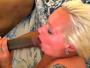 Chubby blonde takes big black cock in all 3 holes