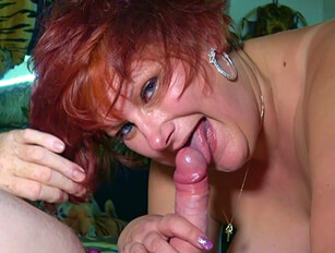 Busty mature redhead eats a cumshot