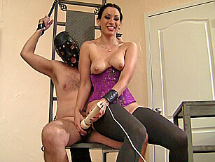 Bound male in chastity toyed by female dom