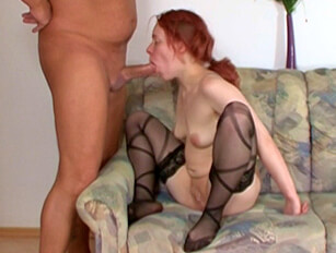 Redhead in black stockings gets shaved pussy fucked