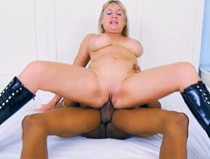 Older blonde in black boots gets a workout with a big cocked black dude