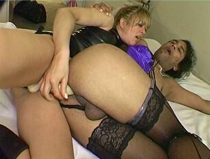Dominant female Starr uses a dildo on a crossdresser