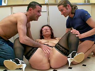 Thick legged older redhead in glasses has a threesome