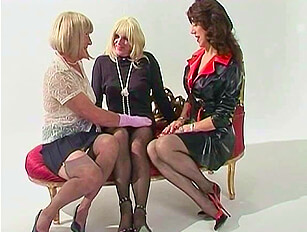 Three dressed cross dressers together with cock sucking